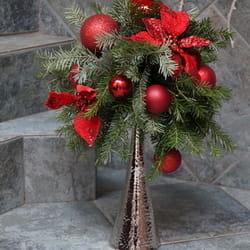 Novogodišnji aranžmani - Cvetni aranžman na svećnjaku
